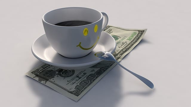 Smiley coffee cup with money